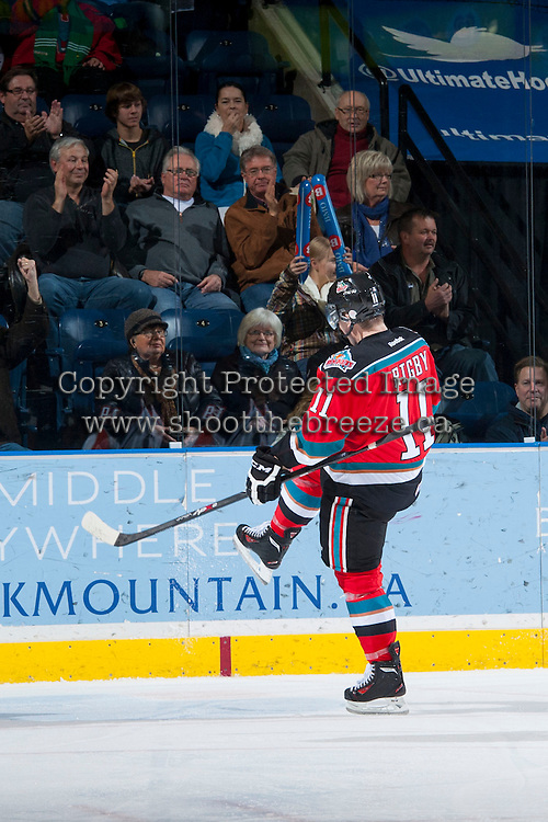 KELOWNA, CANADA - NOVEMBER 30: Carter Rigby #11 of the Kelowna Rockets celebrates a goal against the Kamloops Blazers on November 30, 2013 at Prospera Place in Kelowna, British Columbia, Canada.   (Photo by Marissa Baecker/Shoot the Breeze)  ***  Local Caption  ***