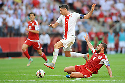 13.06.2015, Nationalstadion, Warschau, POL, UEFA Euro 2016 Qualifikation, Polen vs Greorgien, Gruppe D, im Bild ROBERT LEWANDOWSKI, GURAM KASHIA // during the UEFA EURO 2016 qualifier group D match between Poland and Greorgia at the Nationalstadion in Warschau, Poland on 2015/06/13. EXPA Pictures © 2015, PhotoCredit: EXPA/ Newspix/ RAFAL RUSEK<br /> <br /> *****ATTENTION - for AUT, SLO, CRO, SRB, BIH, MAZ, TUR, SUI, SWE only*****