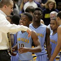 East Carteret celebrates winning the Leon Brogden Holiday Basketball Tournamnet. (Jason A. Frizzelle)