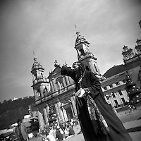 A man preaches in the Plaza Bolivar in front of the main cathedral in downtown Bogotá, Colombia in January of 2004. (Photo/Scott Dalton)