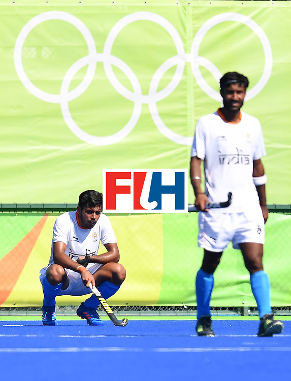 India's Harmanpreet Singh (L) crouches down after Belgium's third goal during the men's quarterfinal field hockey Belgium vs India match of the Rio 2016 Olympics Games at the Olympic Hockey Centre in Rio de Janeiro on August 14, 2016. / AFP / MANAN VATSYAYANA        (Photo credit should read MANAN VATSYAYANA/AFP/Getty Images)