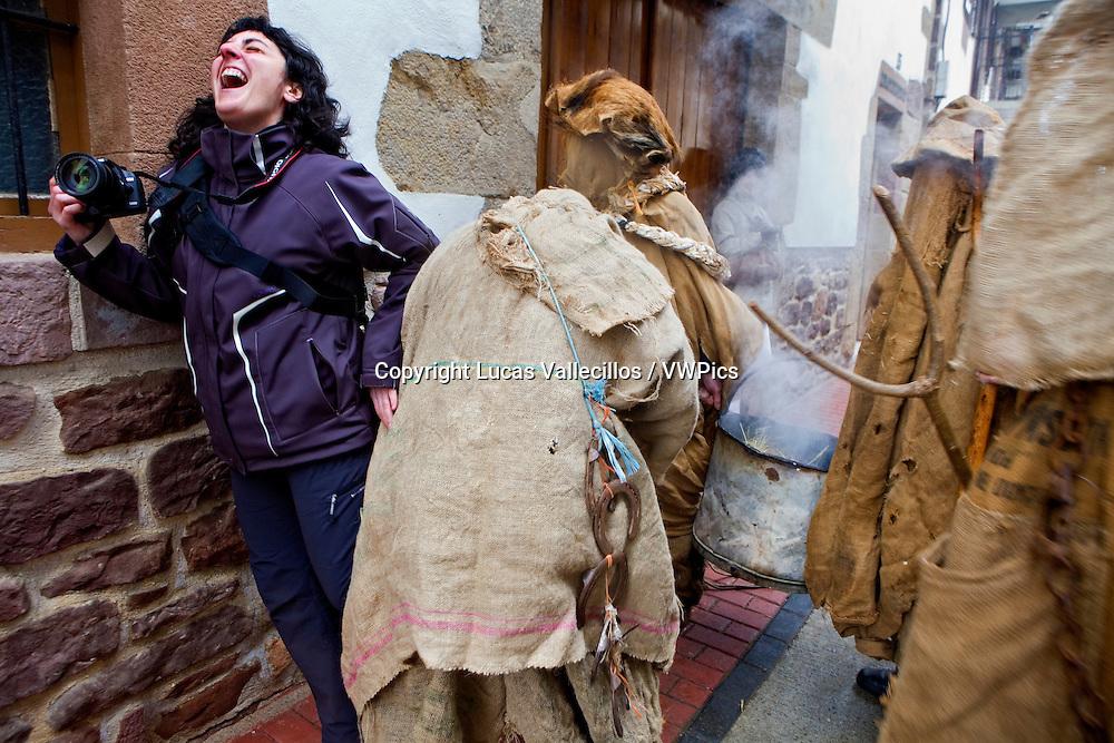 Arotzak (farriers) cath a girl. Lantz carnival. Navarra. Spain