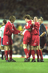 London, England - Monday, December 2, 1996: Liverpool's Steve McManaman celebrates scoring the second goal against Tottenham Hotspur, with team-mates Jason McAteer and Robbie Fowler, during the Premiership match at White Hart Lane. (Pic by David Rawcliffe/Propaganda)