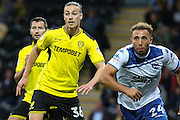 Burton Albion midfielder Jackson Irvine (36) and Bury FC striker Hallam Hope (24) during the EFL Cup match between Burton Albion and Bury at the Pirelli Stadium, Burton upon Trent, England on 10 August 2016. Photo by Aaron  Lupton.