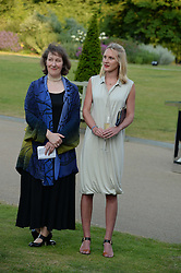 Left to right, Joanna Marschner senior curator for Historic Royal Palaces and Cassie Davies-Strodder, the 'Fashion Rules' Exhibition Curator at the Fashion Rules Exhibition Opening at Kensington Palace, London W8 on 4th July 2013.