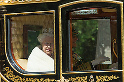 © London News Pictures. 27/05/15. London, UK. The Queen and the Duke of Edinburgh travel from Buckingham Palace to the Palace of Westminster ahead of the State Opening of Parliament, Central London. Photo credit: Laura Lean/LNP/05/15.