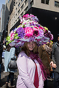 New York, NY, USA-27 March 2016. A woman wears a large and elaborate flower-covered hat in the annual Easter Bonnet Parade and Festival.