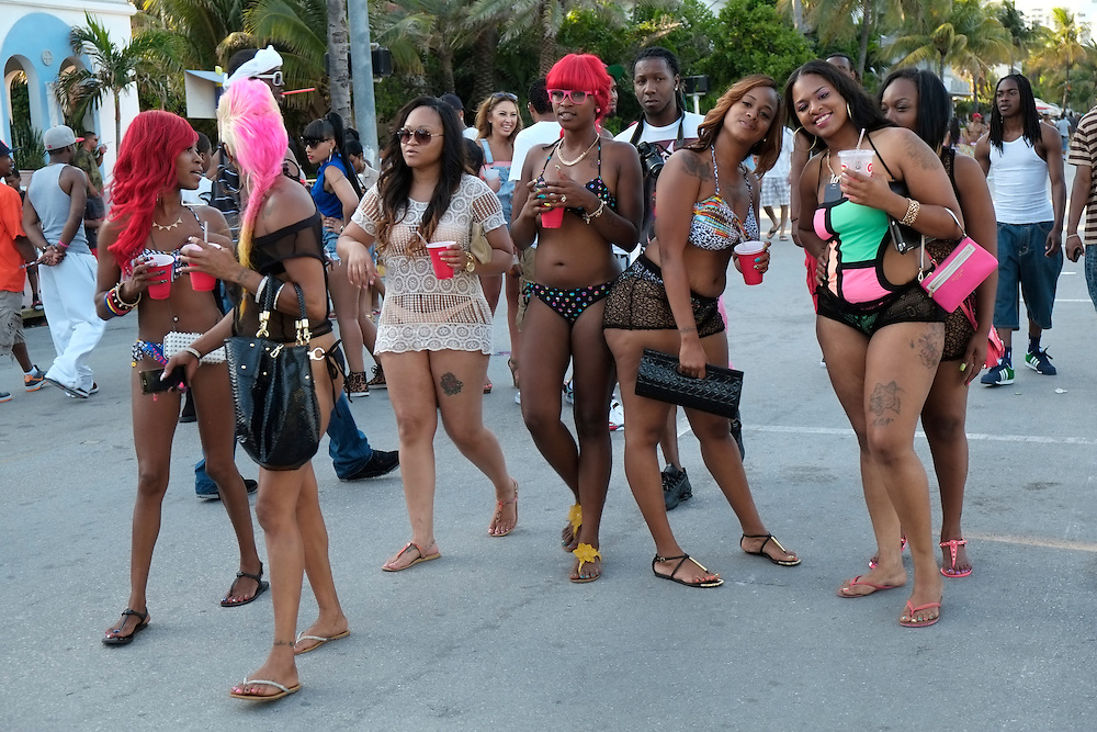 MIAMI BEACH - MAY 25: Girls posing during the Urban Beach Weekend, on May 25, 2013 in Miami Beach. This is the largest Urban Festival in the World, that caters towards the Hip Hop Generation. Over 300.000 participants make the annual trek to South Beach for 4 days full of fun, food, festivities, entertainment, music, and more.