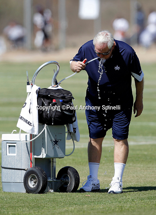 Dallas Cowboys Head Coach Wade Phillips takes a drink of water during NFL football training camp on Wednesday, August 18, 2010 in Oxnard, California. (©Paul Anthony Spinelli)