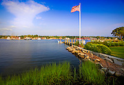 351021-1022G.Huey ~ Copyright: George H.H. Huey ~ Dock and flagpole on the Mystic River along Pearl Street.  Mystic Seaport in distance.  Mystic, Connecticut.