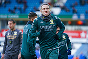 Leeds United defender Luke Ayling (2) warming up during the EFL Sky Bet Championship match between Huddersfield Town and Leeds United at the John Smiths Stadium, Huddersfield, England on 7 December 2019.