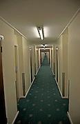 Long hotel corridor with neon lights