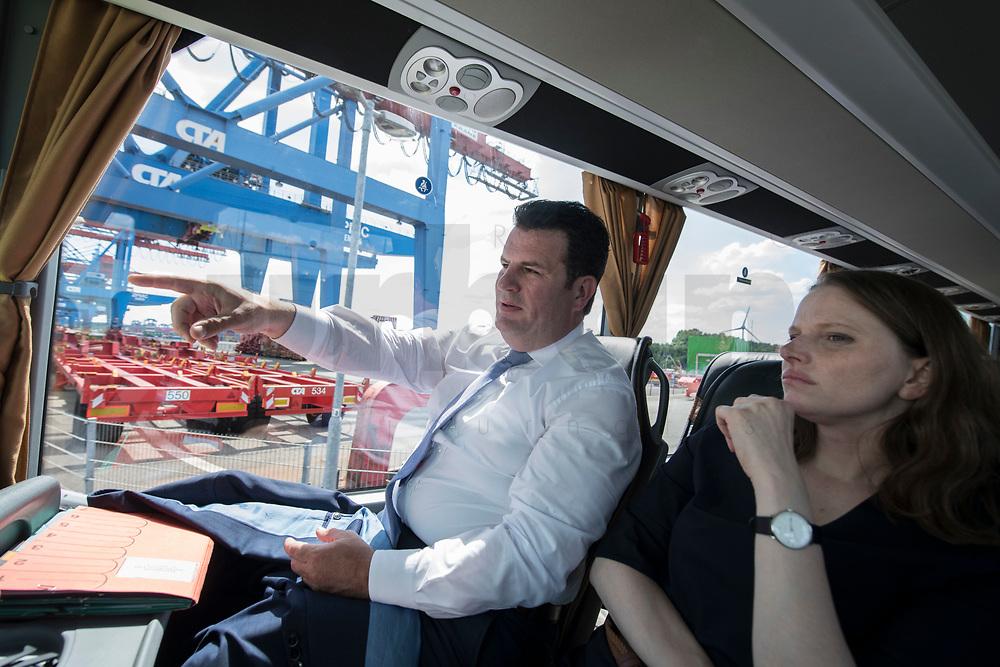 16 JUL 2018, HAMBURG/GERMANY:<br /> Hubertus Heil, SPD, Bundesarbeitsminister, und Dr. Melanie Leonhard, SPD, Senatorin fuer Arbeit, Soziales, Familie und Integration, fahren in einem Bus ueber das Gelaende des  Container Terminal Altenwerder, CTA, der Hamburger Hafen und Logistik Aktiengesellschaft, HHLA, im Rahmen der Sommerreise von Hubertus Heil<br /> IMAGE: 20180716-01-096