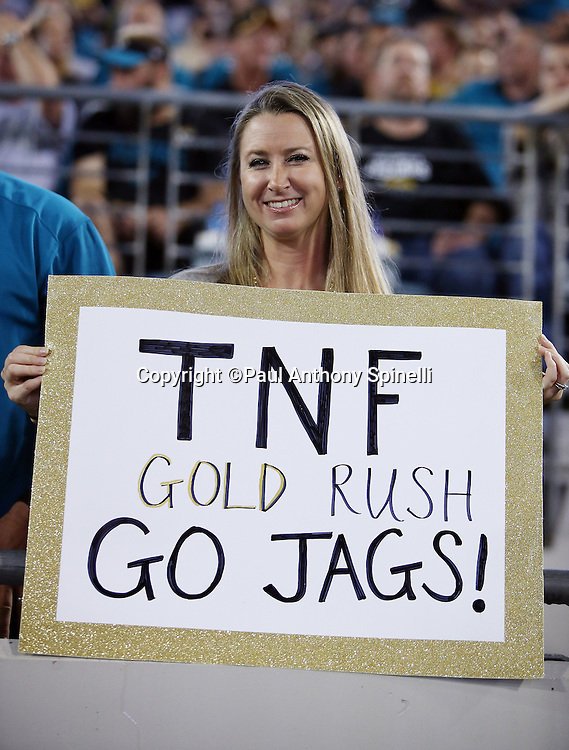 A Jacksonville Jaguars fan holds up a gold rush sign during the 2015 week 11 regular season NFL football game against the Tennessee Titans on Thursday, Nov. 19, 2015 in Jacksonville, Fla. The Jaguars won the game 19-13. (©Paul Anthony Spinelli)