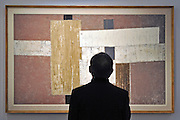© Licensed to London News Pictures. 11/11/2011. London, UK. a visitor looks at A white Structure by William Gear RA, estimated to fetch 15,000 - 25,000 GBP. Sotheby's preview of Modern and Post-War British Art which will offered for sale at auction on 15th November 2011. Photo credit : Stephen Simpson/LNP