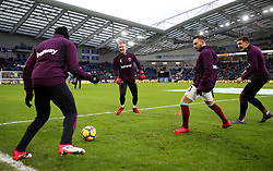 """West Ham United's Joe Hart (centre) and Jordan Hugill (right) warming up  during the Premier League match at the AMEX Stadium, Brighton. PRESS ASSOCIATION Photo. Picture date: Saturday February 3, 2018. See PA story SOCCER Brighton. Photo credit should read: Steven Paston/PA Wire. RESTRICTIONS: EDITORIAL USE ONLY No use with unauthorised audio, video, data, fixture lists, club/league logos or """"live"""" services. Online in-match use limited to 75 images, no video emulation. No use in betting, games or single club/league/player publications."""