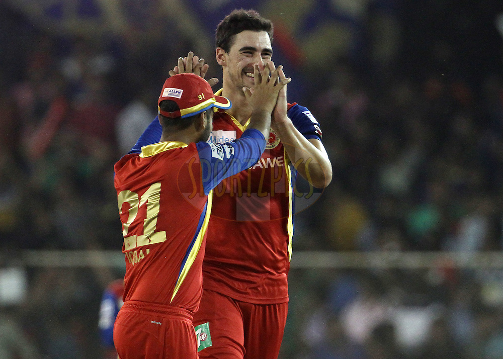 Royal Challengers Bangalore player Mitchell Starc celebrates the wicket Rajasthan Royals player Dhawal Kulkarni during match 22 of the Pepsi IPL 2015 (Indian Premier League) between The Rajasthan Royals and The Royal Challengers Bangalore held at the Sardar Patel Stadium in Ahmedabad , India on the 24th April 2015.<br /> <br /> Photo by:  Vipin Pawar / SPORTZPICS / IPL