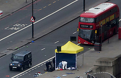 The aftermath of the terror attack on London Bridge and Borough Market on Saturday 3rd June, 2017. Forensic officers place markings at the scene of the terror attack as the police investigation  starts  on London Bridge.<br />