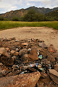 Trash left at a campsite along Proctor Road, Madera Canyon, Coronado National Forest, Sonoran Desert, Santa Rita Mountains, Green Valley, Arizona, USA.