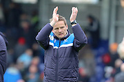 AFC Wimbledon Manager Neal Ardley salutes the fans at the final whistle during the Sky Bet League 2 match between AFC Wimbledon and Crawley Town at the Cherry Red Records Stadium, Kingston, England on 16 April 2016. Photo by Stuart Butcher.