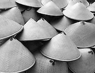 A pile of hand woven hats for sale near Prambanan, Yogyakarta, Java, Indonesia.