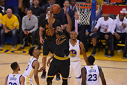 The Cleveland Cavaliers' Tristan Thompson (13) shoots over the Golden State Warriors' Draymond Green (23) during the first quarter of Game 5 of the NBA Finals at Oracle Arena in Oakland, Calif., on Monday, June 12, 2017. (Photo by Jose Carlos Fajardo/Bay Area News Group/TNS) *** Please Use Credit from Credit Field ***