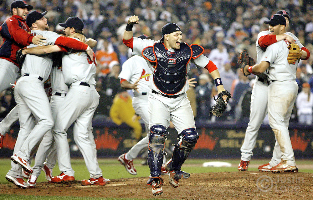 The St. Louis Cardinals', including Yadier Molina (C), celebrate after defeating the New York Mets 3-1 in game seven of the National League Championship Series at Shea Stadium in Flushing, New York on Thursday 19 October 2006.