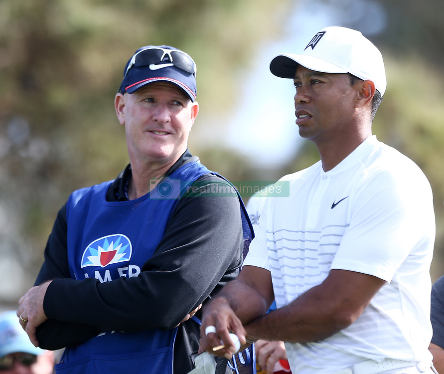 January 27, 2018 - San Diego, California, United States - Tiger Woods (R) and caddie Joe LaCava wait on the 18th tee during the third round of the 2018 Farmers Insurance Open at Torrey Pines GC. (Credit Image: © Debby Wong via ZUMA Wire)