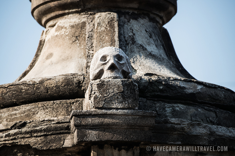 MEXICO CITY, MEXICO --A stone skull sits at the base of a statue outside the Metropolitan Catehdral. Built in stages from 1573 to 1813, the Mexico City Metropolitan Cathedral is the largest Roman Catholic cathedral in the Americas. It sits in the heart of the historic quarter of Mexico City along one side of the the Zocalo.