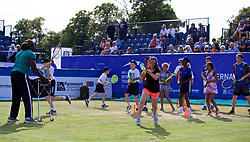 LIVERPOOL, ENGLAND - Saturday, June 23, 2018: Tennis coach Sam Jollah teaches young tennis players with a Spanish training exercise during day three of the Williams BMW Liverpool International Tennis Tournament 2018 at Aigburth Cricket Club. (Pic by Paul Greenwood/Propaganda)