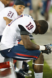 November 6, 2010; Stanford, CA, USA; Arizona Wildcats wide receiver William Wright (19) sits on the bench with his head down during the third quarter against the Stanford Cardinal at Stanford Stadium.  Stanford defeated Arizona 42-17.