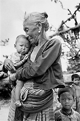 BANGLADESH COX'S BAZAAR DISTRICT UKHIA JUL94 - A Chakma mother holds her child after a hurricane hit the area and destroyed most dwellings of this buddhist tribe. About 15,000 people were reported dead after this natural calamity which occurs on an annual basis...jre/Photo by Jiri Rezac..© Jiri Rezac 1994