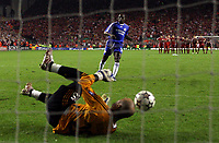 Photo: Paul Thomas.<br /> Liverpool v Chelsea. UEFA Champions League. Semi Final, 2nd Leg. 01/05/2007.<br /> <br /> Geremi of Chelsea has his penalty saved by keeper Pepe Reina (Ground) of Liverpool.