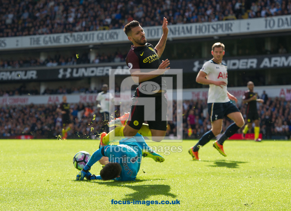 Goalkeeper Hugo Lloris of Tottenham Hotspur makes a save from Sergio Aguero of Manchester City  during the Premier League match at White Hart Lane, London<br /> Picture by Alan Stanford/Focus Images Ltd +44 7915 056117<br /> 02/10/2016