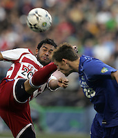 FC Dallas' Carlos Ruiz, left, kicks the ball away from Seattle Sounders' Taylor Graham and is called for high kick in the first half of U.S. Open Cup Semifinals USL soccer action at Qwest Field in Seattle, on Tuesday, Sept. 4, 2007. (AP Photo/Kevin P. Casey)