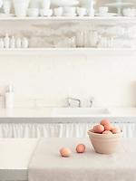 Brown Eggs in Bowl in White Kitchen