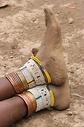 Beads on the legs of a Samburu Maasai woman. Samburu Maasai is an ethnic group of semi-nomadic people Photographed in Samburu, Kenya