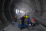 Workers inspecting a hole during construction of the Songshan line of Taipei's MRT system.