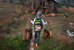 On school days, the children help out at the farm before going to school. At Ka Myaw Gyi village in the outskirts of Dawei, Myanmar.