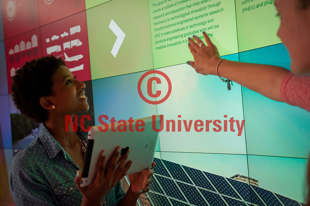 Undergraduate engineering students use the micro tile wall at the IPearl Immerstion theater at Hunt Library.