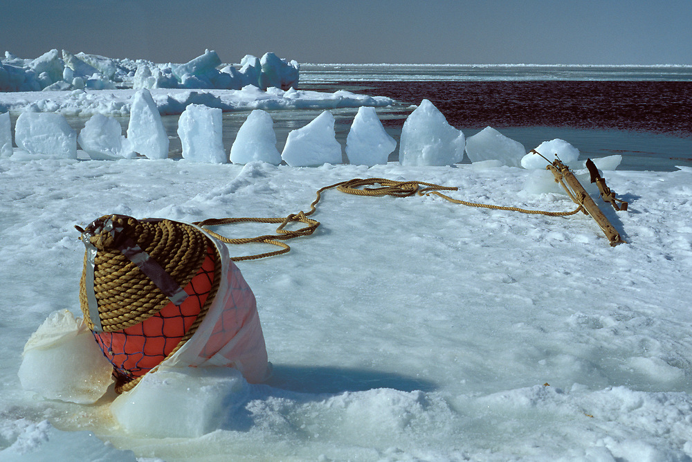 Barrow, Alaska, Harpoon and Buoy at a whaling camp on the edge of sea ice on the Chukchi Sea. Ice blocks are set up to trap the buoy.