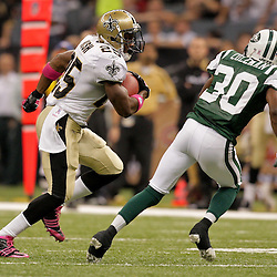 2009 October 04: New Orleans Saints running back Reggie Bush (25) runs by New York Jets cornerback Drew Coleman (30) during the first half of a week four regular season game between the New Orleans Saints and the New York Jets at the Louisiana Superdome in New Orleans, Louisiana.