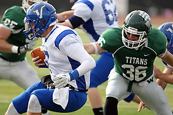 15 November 2014:  Luke Roth captures T.D. Conway during an NCAA division 3 football game between the North Park Vikingsand the Illinois Wesleyan Titans in Tucci Stadium on Wilder Field, Bloomington IL