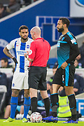 Lee Mason (Referee) & Jurgen Locadia (Brighton) in conversation after awarding a yellow card to Locadia with Kyle Bartley (West Brom) waiting patiently on the sidelines during the FA Cup fourth round match between Brighton and Hove Albion and West Bromwich Albion at the American Express Community Stadium, Brighton and Hove, England on 26 January 2019.
