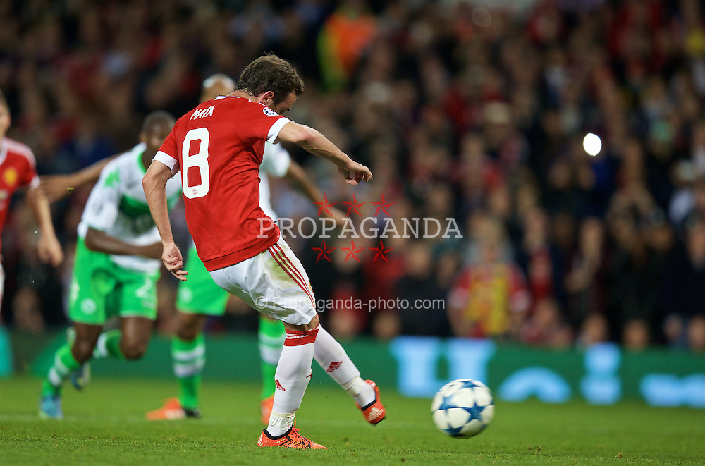 MANCHESTER, ENGLAND - Wednesday, September 30, 2015: Manchester United's Juan Mata scores the first goal against VfL Wolfsburg from a penalty kick during the UEFA Champions League Group B match at Old Trafford. (Pic by David Rawcliffe/Propaganda)