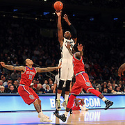 Kadeem Batts, Providence, shoots for three during the Providence Vs St. John's Red Storm basketball game during the Big East Conference Tournament at Madison Square Garden, New York, USA. 12th March 2014. Photo Tim Clayton