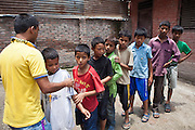 Young Nepalese boys line-up into a queue for penalties during their football session in the back yard of the Voice of Children rehabilitation center in Kathmandu, Nepal. The not-for-profit organisation supports street children and those who are at risk of sexual abuse through educational and vocational training opportunities, health services and psychosocial counseling.