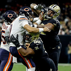 Oct 29, 2017; New Orleans, LA, USA; New Orleans Saints defensive tackle Tyeler Davison (95) and defensive tackle Sheldon Rankins (98) hit Chicago Bears quarterback Mitchell Trubisky (10) as a he throws during the first half of a game at the Mercedes-Benz Superdome. The Saints defeated the Bears 20-12. Mandatory Credit: Derick E. Hingle-USA TODAY Sports