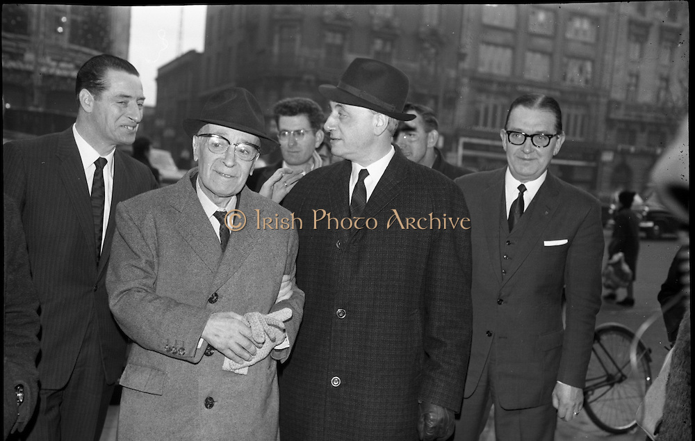 Michael MacLiammóir, Variety Club luncheon..1964.15.12.1964..12.15.1964..15th December 1964..Image shows Mr Jimmy O'Dea (grey overcoat) leading members of the theatre profession into The Metropole on O'Connell Street, Dublin for the Variety Club Luncheon to honour  Mr Michael MacLiammóir.