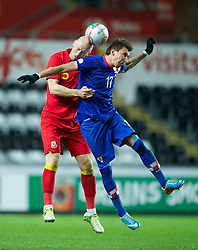 SWANSEA, WALES - Tuesday, March 26, 2013: Wales' James Collins in action against Croatia's Mario Mandzukic during the 2014 FIFA World Cup Brazil Qualifying Group A match at the Liberty Stadium. (Pic by David Rawcliffe/Propaganda)